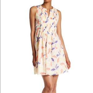 CeCe pleat fit and flare feather dress
